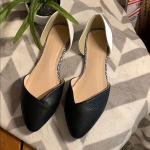 Trendy black and white flats